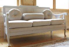 a charming cane sofa