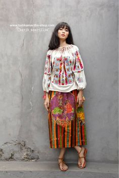 Batik Amarillis made Indonesia proudly presents Batik Amarillis's La Romaine  blouse -  the blouse itself is Henri Matisse' s Panting  inspired ' La blouse Romaine' - such a beautiful blouse which is Romanian folk blouse inspired with its colorful Smocked and tassels  which also features Hungarian embroidery inspired