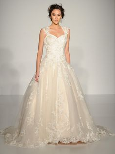 Maggie Sottero lace overlay ball gown wedding dress with lace cap sleeves