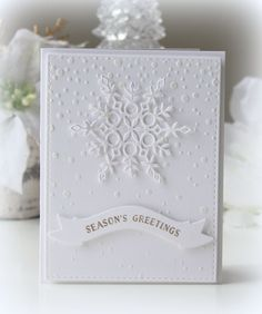handmade winter/Christmas card ... all white ... snow theme ...  stenciled falling snow with a delicate die cut snowflake on top ... Simon Says Stamp