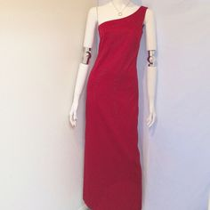 """My Michelle Off the Shoulder Formal Dress My Michelle Off the Shoulder Red Formal Dress. Size 5/6. Red Jewel Detailing in front of dress. 100% Polyester, Hand Wash Cold. Made in the USA. Measurements: Armpit to Armpit 15"""", Waist 14.5"""", Length 55"""". My Michelle Dresses"""