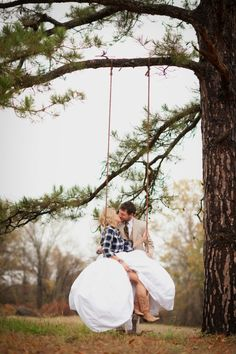 Love this idea, rustic wedding, a flannel shirt over the dress for some of the picture, cowboy boots..this is so me! :)