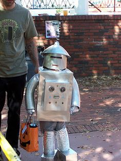 "What a cute little, homemade robot!!  The original source wrote: ""This is from 2008. My then 4 year old wanted to be a robot and my husband made this out of boxes and paint. It even lit up! He won the grand prize!""  (found & quoted from: kitchenfunwithmy3...)"