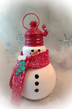 Upcycled light bulbs are handcrafted into adorable snowmen. These glass bulbs are painted with enamel paint for durability and glittered for sparkle. Christmas Ornament Crafts, Diy Christmas Ornaments, Christmas Art, Christmas Projects, Simple Christmas, Handmade Christmas, Holiday Crafts, Christmas Decorations, Christmas Light Bulbs