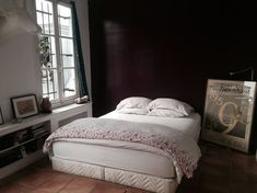 Entire home/apt in Paris, France. Large family room with vaulted ceilings and mezzanine. Fireplace, balcony, and rooftop terrace off . Paris Apartment Rentals, Paris Apartments, Rental Apartments, Large Family Rooms, Rooftop Terrace, Beams, Master Bedroom, Furniture, Home Decor