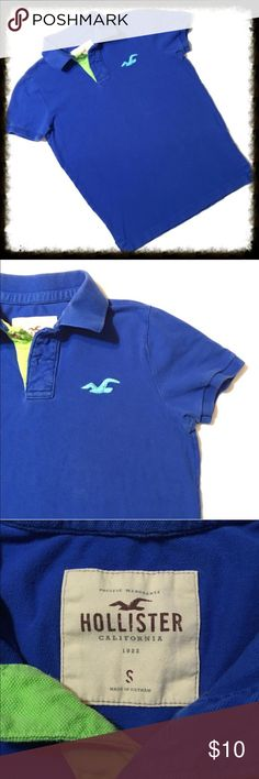 AEO Blue Athletic Fit Polo w/ Lime Green Eagle XS Stretch pique for comfort & ease of movement Classic fit Two-button polo placket Ribbed collar and armbands Vented hem Embroidered icon at the chest  100% Cotton. * In good condition with wear showing on inside of collar. See picture. American Eagle Outfitters Shirts Polos