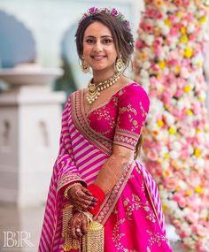 Looking for Bridal mehendi look in Sabyasachi lehenga? Browse of latest bridal photos, lehenga & jewelry designs, decor ideas, etc. on WedMeGood Gallery. Lehenga Hairstyles, Indian Bridal Hairstyles, Indian Bridal Outfits, Indian Dresses, Mehendi Outfits, Pink Bridal Lehenga, Pink Lehenga, Lehenga Choli, Lehriya Saree