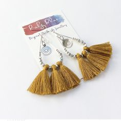 Silver and Ochre Tassel earrings, Silver Drop tassel earrings, Mustard tassel earrings handmade by rubybluejewels by Rubybluejewels on Etsy https://www.etsy.com/au/listing/610756827/silver-and-ochre-tassel-earrings-silver