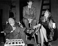 Nigel Bruce, Basil Rathbone and Evelyn Ankers relax between takes of Sherlock Holmes and the Voice of Terror