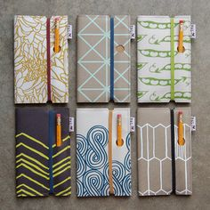 Awesome silkscreened fabric sketchbook covers, from Piano Nobile. I like the idea of having a hole for the pencil Diy Notebook, Handmade Notebook, Handmade Books, Binding Covers, Book Binding, Sketchbook Cover, Beautiful Notebooks, Sketchbook Inspiration, Journal Covers