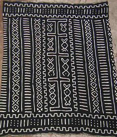 Mali- Mudcloth Fabric (Bogolan)             cloth, river soil, leaves, sun