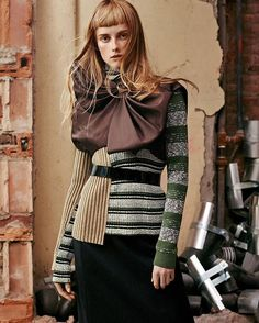 maisonmargiela: @voguemagazine captures Look 15 from our Autumn-Winter 2016 'Défilé' Collection for the August issue. Look 15 is comprised of a draped sleeveless top in brown duchesse silk satin layered with a ribbed patchwork turtleneck sweater and a navy wool skirt. Photographed by Gregory Harris and styled by Tonne Goodman.