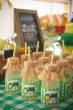 Individual lemonade bottles and drinking straw decorated with John Deere finishing touches.  See more John Deere birthday party ideas at www.one-stop-party-ideas.com