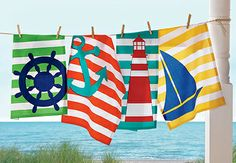 nautical themed tag dishtowels in bright colors and stripes: ship's wheel, anchor, lighthouse, sailboat