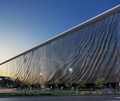 Brisbane Airport Domestic Car Park Facade by Urban Art Projects: kinetic facade composed of 250,000 aluminium panels