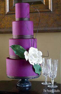 bold merlot fondant wedding cake with white accent flower by the pastry studio