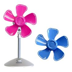 Keystone's 10 in. Flower Personal Fan has purple and pink interchangeable heads. This cute little flower fan with soft plastic safety blades is perfect for desk or tabletop use. Personal Fan, Desk Fan, Wall Fans, Fan Blades, Soft Plastic, Night Light, Ceiling Fan, Pink Blue, Cart