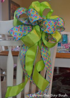 A video tutorial showing an easy way to tie a bow with multiple ribbons. I will walk you through an easy way to tie decorative bows of your own.