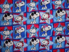 He encontrado este interesante anuncio de Etsy en https://www.etsy.com/es/listing/209591168/red-white-blue-snoopy-cotton-fabric-by