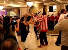 Bucky steels the bride from the groom for a dance!
