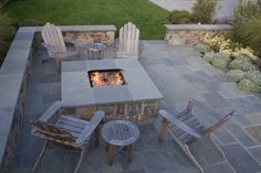 love the fire pit + adirondack chairs, and the patio colors work nicely with them as well. traditional landscape by Shades Of Green Landscape Architecture
