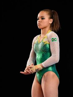 Thais Santos of Brazil prepares to compete on the floor exercise during the women's individual all-around final of the Artistic Gymnastics World Championships on October 2017 at Olympic Stadium in Montreal, Canada. Gymnastics World, Gymnastics Photography, Gymnastics Pictures, Sport Gymnastics, Artistic Gymnastics, Olympic Gymnastics, Gymnastics Leotards, Gymnastics Routines, Gymnastics Championships