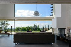 Home Located on a Sloping Site with High Ceilings and Floor To Ceiling Windows