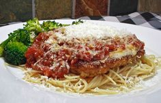 Veal Parmesan (To serve, place a veal cutlet over a bed of angel hair pasta, top with marinara, and garnish with fresh parsley and Parmesan cheese.) _ Comfort Food for Black Forest Fire Victims