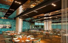 Gold and Turquoise Restaurant Decor in Barcelona specially textured glass restaurant decor