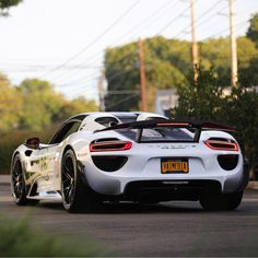 Porsche 918 Spider painted in White w/ a black Salzburg racing livery and Weissach Package Photo taken by: @nyexoticcars on Instagram (@aimotorsports on Instagram is the owner of the car)