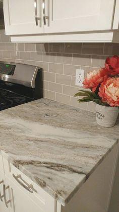 Fantasy Brown Granite Counters, Taupe Glass Tile Backsplash and White Shaker Cabinets. #KitchenCountertopgranitecolors