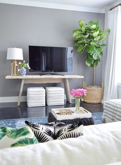tv wall fiddle leaf fig in basket toulouse ottoman cubes black and white gold bamboo lamp blue vintage inspired rug gray accent wall summer home tour Cozy Living Rooms, New Living Room, Apartment Living, Home And Living, Living Room Decor, Bedroom Decor, Apartment Therapy, Tv In Bedroom, Bedroom Tv Stand