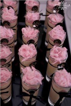 dessert table of mini individual chocolate mousse topped with pink cotton candy