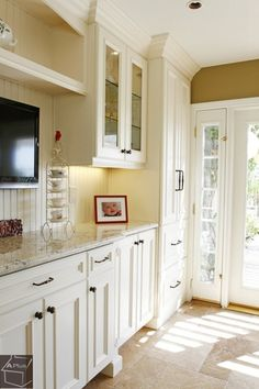 Traditional Kitchen with French doors, tv wall mount, travertine tile floors, Inset cabinets, Simple granite counters Ivory Kitchen Cabinets, Inset Cabinets, Kitchen Cabinet Remodel, Painting Kitchen Cabinets, Orange County, Traditional Kitchen, Kitchen Design, Kitchen Ideas, Country Kitchen