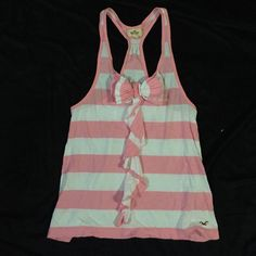 Striped Tank Pink and White striped tank. Ruffle and Bow detail on front. Loose fitting. Racerback style. Never been worn. Cute for Spring/Summer! Hollister Tops Tank Tops
