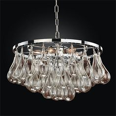 The sleek polished chrome frame is adorned with contemporary pear shaped glass elements on the Concorde 3 light chandelier from Glow Lighting. The modern design is ideal for urban or suburban living. Large Pendant Lighting, 3 Light Chandelier, Pendant Chandelier, Globe Pendant, Pendant Lights, Candelabra Bulbs, Concorde, Glass Globe, Home Lighting