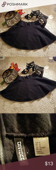 Mini,  skater skirt, black size Medium by Divided Flared, black skirt,  quilted pattern in black.  In great preloved condition. Back zipper for detail only.  Pull up is sufficient. Divided Skirts Mini