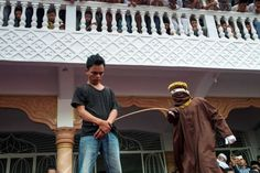 Public humiliation after Friday prayers in Aceh as sinners receive the cane for moral offences. Man suffers public caning in Aceh