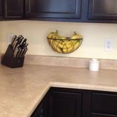 Hanging planter basket re-purposed as a fruit holder. Frees up valuable counter space