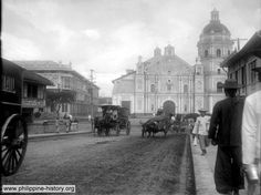 An old Photo of Binondo, a district in Manila, circa early 1900s. Under the backdrop of the Binondo church are horse and carabao drawn carriages.     - from http://www.philippine-history.org