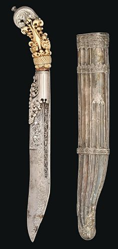 *A FINE SINHALESE DAGGER (PIHA KAETTA)   SRI LANKA, 18TH CENTURY   The broad single-edged steel blade with fuller along the back edge decorated with silver-overlaid arabesques, the forte covered with cast and pierced silver panels, the carved ivory hilt with silver-pommel cap, the original silver scabbard with silver filigree mounts