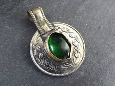 Buy Now Silver Kuchi Coin Pendant Green Oval Glass Afghan Coin... Photo Shape, Copper Blush, Coin Pendant, Coins, Gemstone Rings, Pendants, Brass, Afghanistan, Green