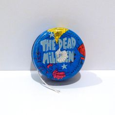 The Dead Milkmen - Hollywood Records Gimmick - Promotional only item - Soul Rotation Featuring The Secret Of Life - printed on a Metal Yo Yo with graphics like a world globe - 1992  This was an item we received at Mohawk Music in Tulsa to promote the band The Dead Milkmen, and their record release in 1992 entitled Soul Rotation. It was given exclusively to people in the music industry from the bands record label, and was never sold to the general public. It is a cool yo-yo with parts of the…