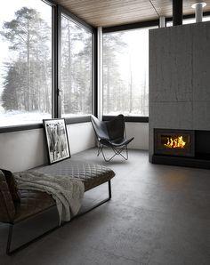 Salón con chimenea. Pavimento porcelánico de gran formato (100 x 100 cm.) imitando cemento. Imagen 3D fotorrealista. actua.es