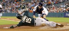 Cut down -        Oakland Athletics' Brett Lawrie is tagged out at home plate by Houston Astros catcher Jason Castro during the second inning on May 19 in Houston.  - © David J. Phillip/AP
