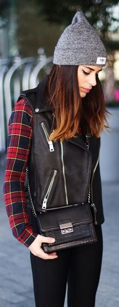 My leather vest with a plaid button up.