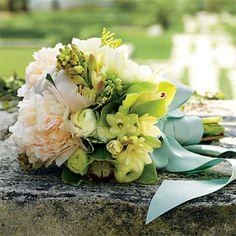 freesia, cymbidium orchids, viburnum, parrot tulips, tuberose, ranunculus, peonies and pittosporum