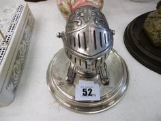 A VICTORIAN SILVER PLATED NOVELTY INKWELL IN THE FORM OF KNIGHTS ...