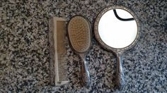 Welcome to my online store! For sale I have a used Vintage Ornate Silverplate 3 Piece Vanity Set Brush Comb Mirror. <br> <br>The vintage silver plate 3 piece vanity set is made in China. The brush measures 8 X 2 1/2, the mirror measures 9 1/2 X 5, and the comb measures 7 X 2. This set is heavy, and solid   <br> <br>Thanks for looking! <br> <br>Please check out my other items: http://thecornerstoreandmore.blogspot.com/   Thanks!