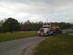 Peterbuilt Truck with Caterpillar Excavator coming in our driveway